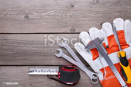 istock Different construction tools on grey wooden background with copy space. 1146634495