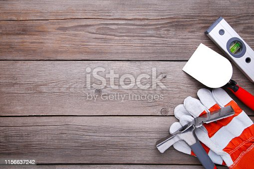 istock Different construction tools on grey wooden background with copy space. 1156637242