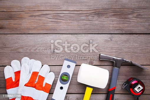 istock Different construction tools on grey wooden background with copy space. 1156637255