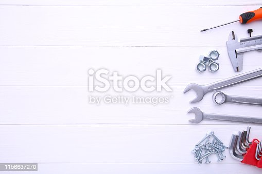 istock Different construction tools on white wooden background with copy space. 1156637270