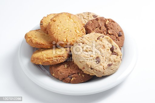 Different cookies in plate on a white background close-up