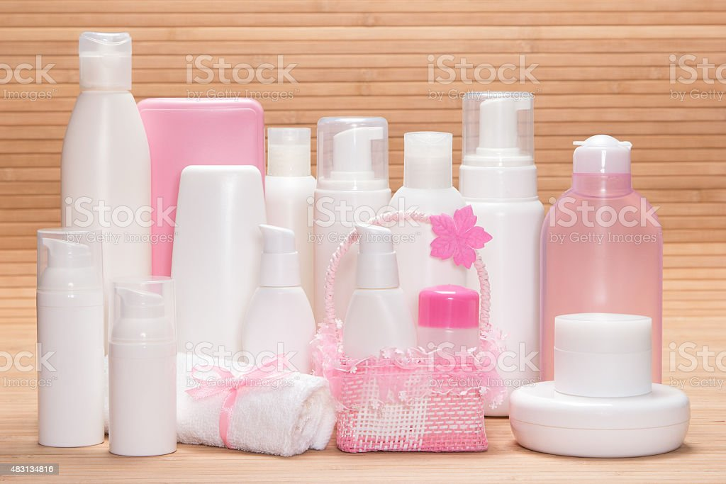 Different cosmetic products for skincare on wooden surface stock photo