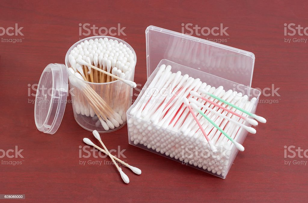 Different cotton swabs in rectangular and round plastic containe stock photo