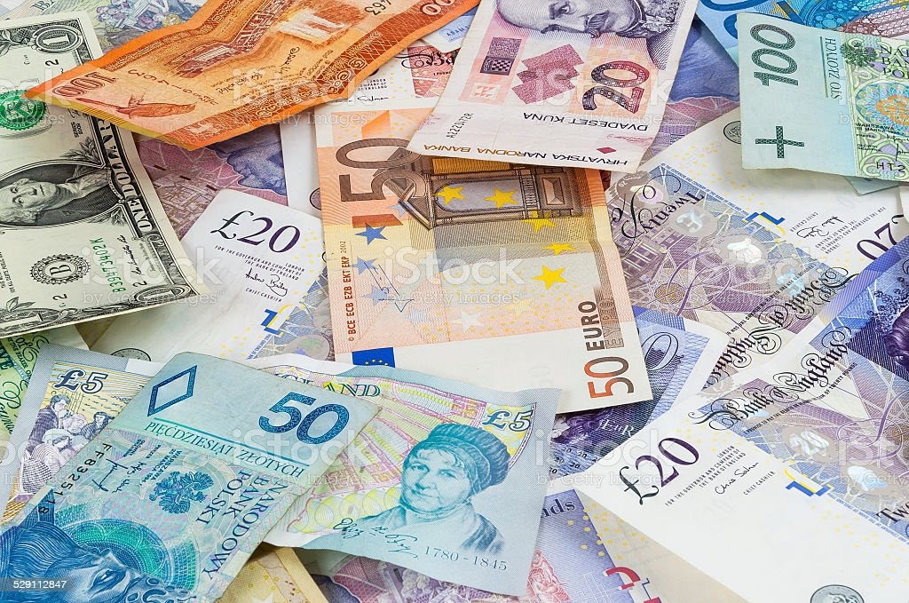 Different currencies banknotes background stock photo