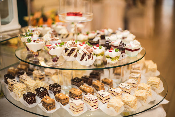 Different delicious desserts and cakes on the buffet table stock photo