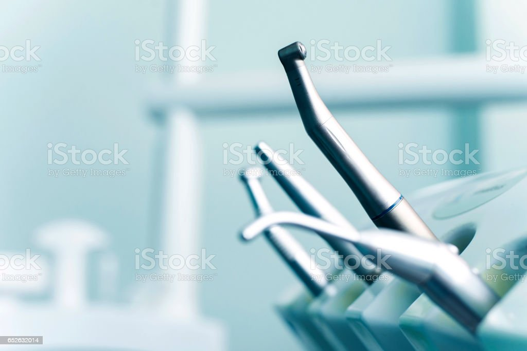 Different dental instruments and tools in a dentists office stock photo