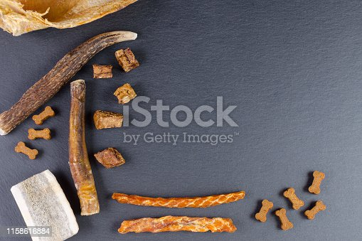 istock different dog food and snack, chicken filet, antlers, lung, ear on black background 1158616884