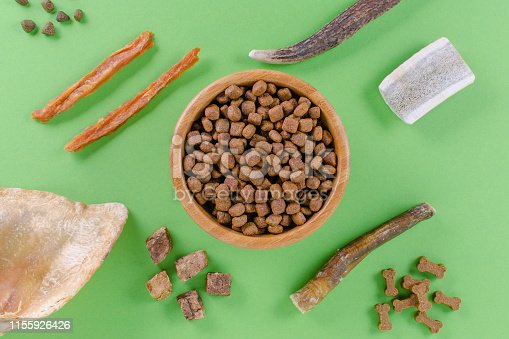 istock different dog food and snack, chicken filet, antlers, lung, ear on green background 1155926426