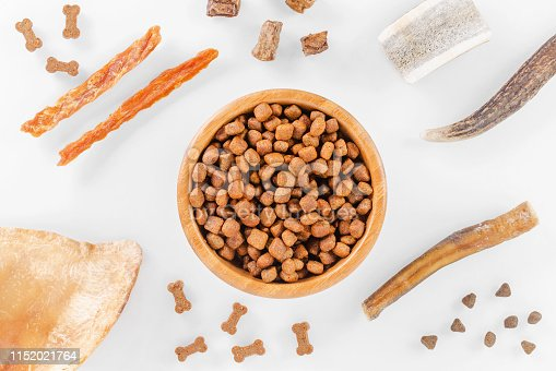 istock different dog food and snack, chicken filet, antlers, lung, ear on white background, top view 1152021764