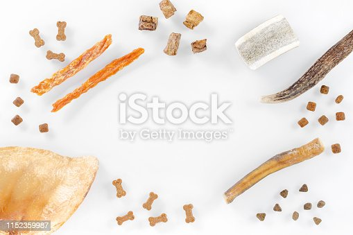 istock different dog food and snack, chicken filet, antlers, lung, ear on white background, top view with copy space 1152359987