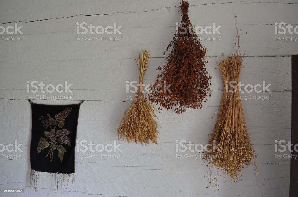 Different dried herbs and tapestry royalty-free stock photo