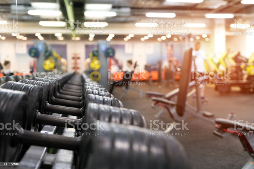Different dumbbell weights in fitness center stock photo