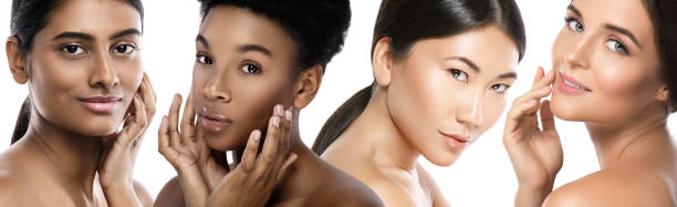 Different ethnicity women - Caucasian, African, Asian and Indian. stock photo