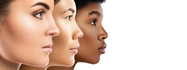 Different ethnicity women - Caucasian, African, Asian. stock photo