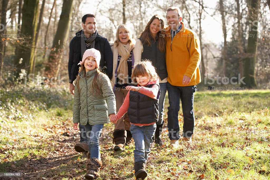 Different family generations walking together in winter royalty-free stock photo