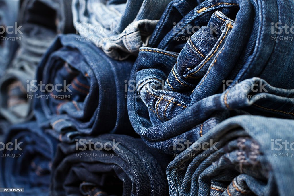 Different folded jeans stock photo