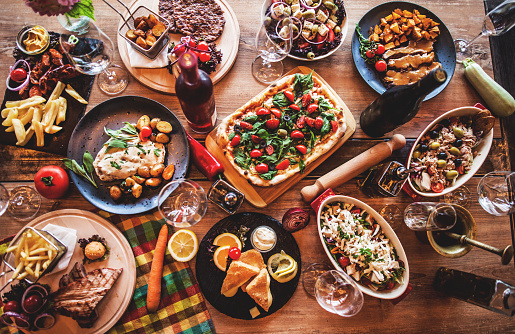 Different food cooked on a wooden table