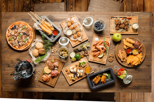 Different food cooked on the grill on a wooden table with copy space. stock photo