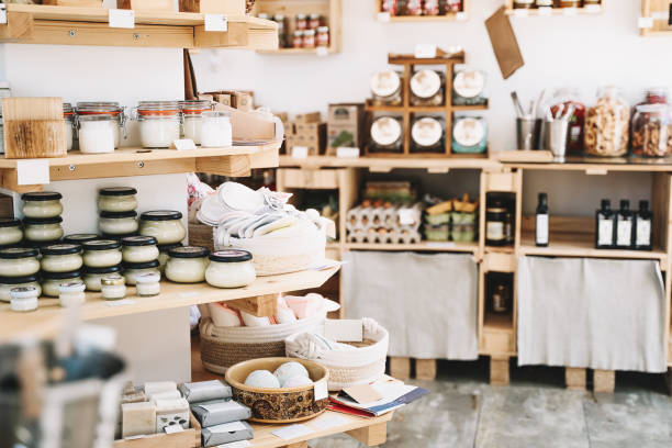 Different food goods and personal hygiene or cosmetics products in zero waste shop. Plastic free grocery store. stock photo