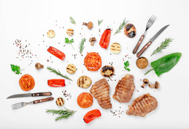 different food grilled on a white background - grilled vegetables stock photos and pictures