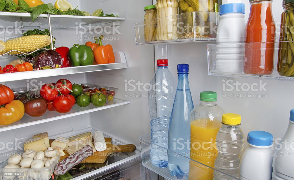 Different food products inside a refrigerator stock photo