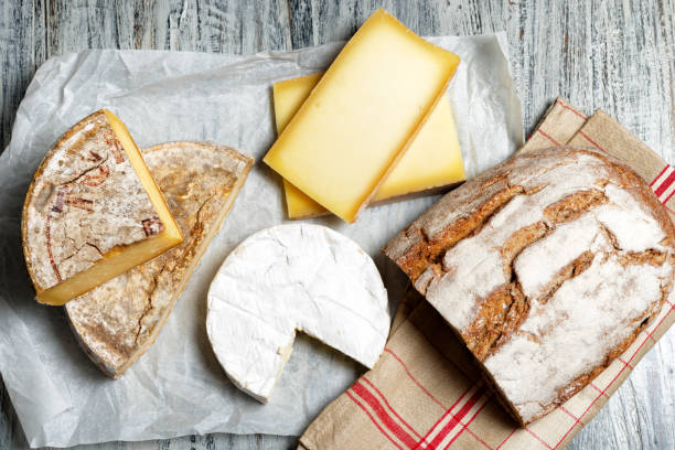 Different french cheeses with a bread stock photo