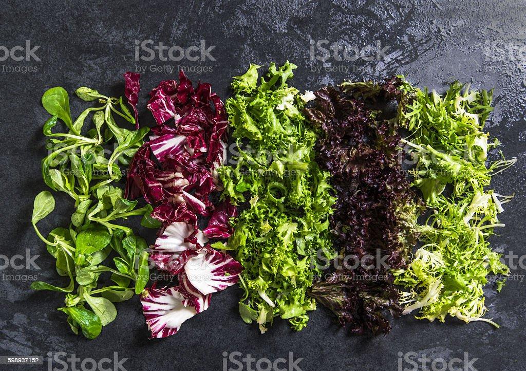 different fresh salad on dark slate stock photo