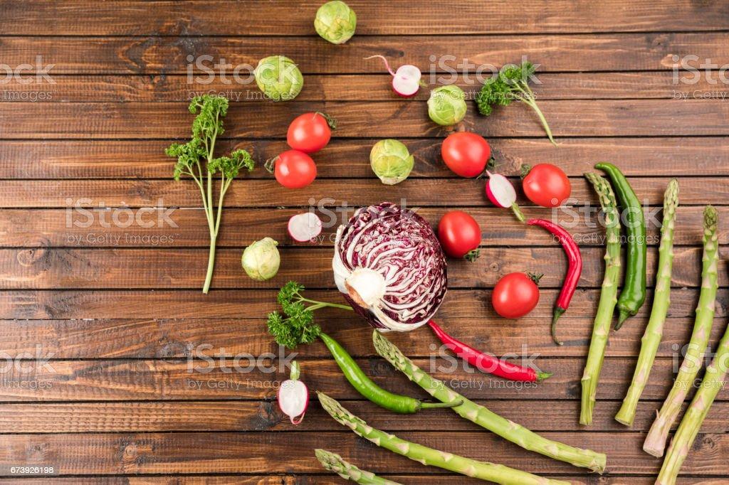 different fresh seasonal vegetables on wooden table top texture photo libre de droits