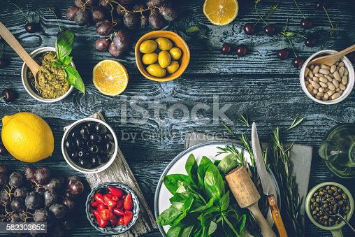 istock Different fruit , herbs and appetizers on the wooden table horizontal 582303652