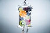 istock Different Fruit Slices Inside Saline Bag Hanging In Hospital 1188462420