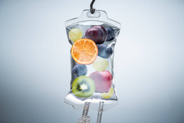 Different Fruit Slices Inside Saline Bag Hanging In Hospital stock photo