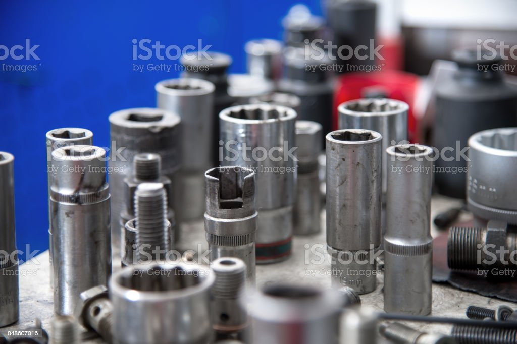 different fuel bolts and end keys on a workbench in a fuel workshop stock photo