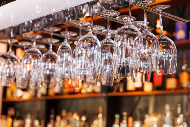 different glasses hanging over the bar. Soft focus. selective focus stock photo