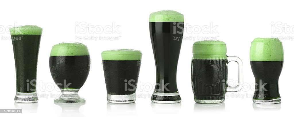 Different glasses of St. Patrick's Day green beer royalty-free stock photo