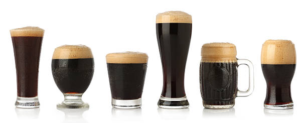 Different glasses of stout beer Different glasses of stout beer, isolated on white  bitter ale stock pictures, royalty-free photos & images