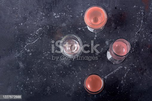 Different glasses with rose wine on a dark background. Wine tasting concept. Close up, copy space, law key