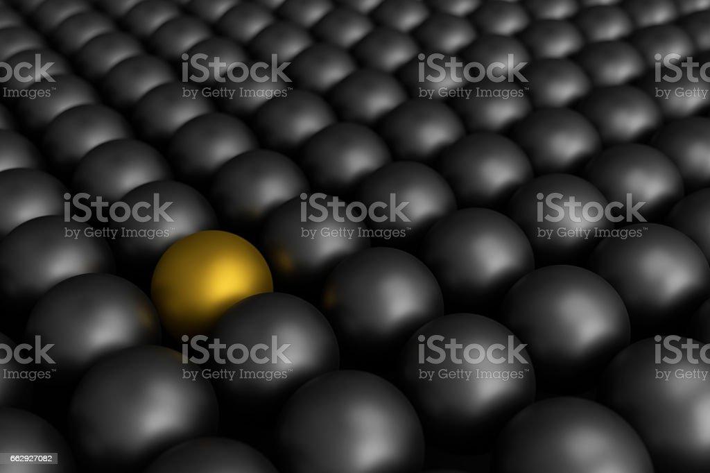 Different golden ball among black balls,3d rendering stock photo