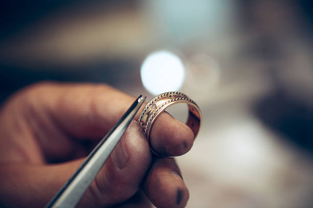 Different goldsmiths tools on the jewelry workplace. Jeweler at work in jewelry stock photo