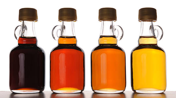different grades of maple syrup - maple syrup stock photos and pictures