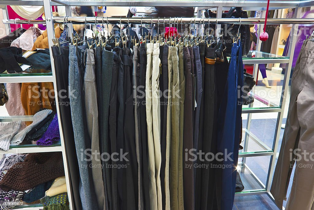 different group colored jeans hanging on a hanger in store royalty-free stock photo