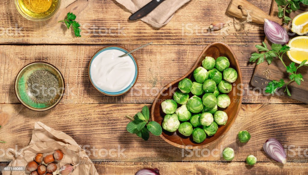 Different ingredients for cooking healthy food on the wooden table,...