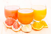 Different juice in glass with pieces of fresh fruits. Vitamin healthy background