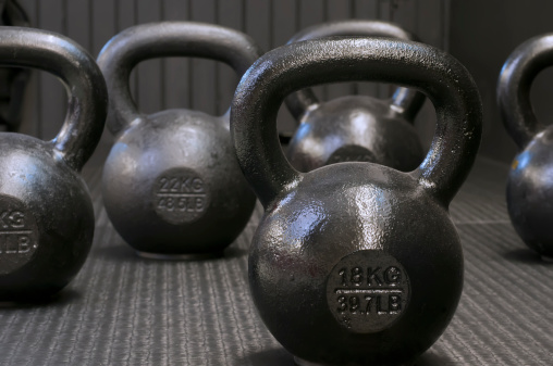Different Kettlebell Weights On Carpet Floor Stock Photo - Download Image Now