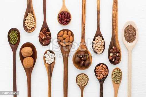 istock Different kind of beans and lentils in wooden spoon on white wood background. mung bean, groundnut, walnuts, macadamia, almond, soybean, red kidney bean, black bean, sesame, corn, red bean and brown pinto beans 848506450