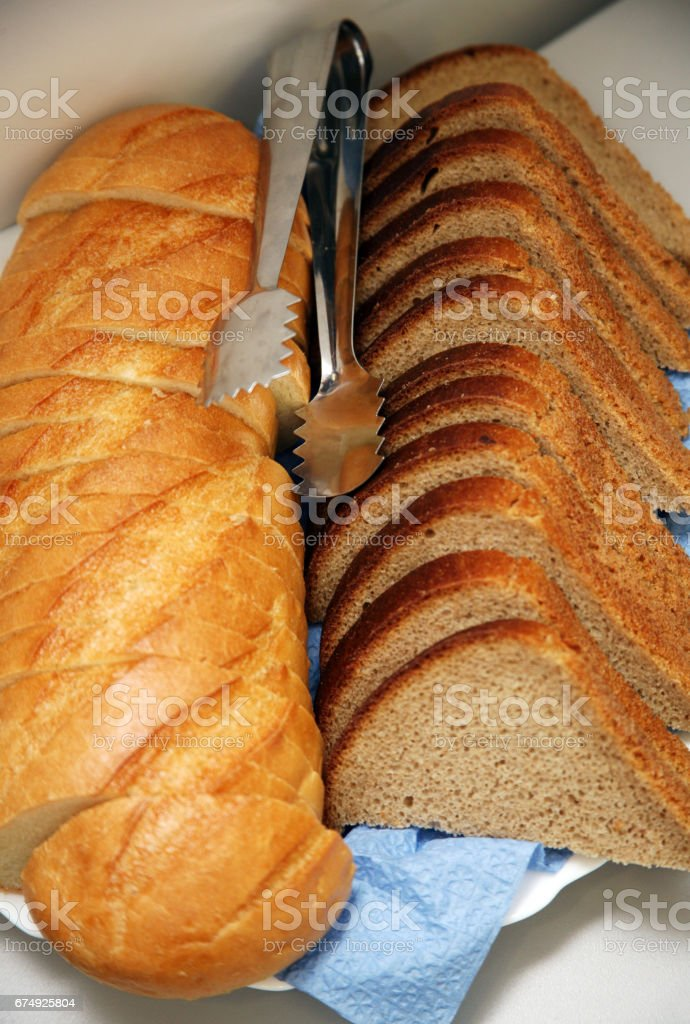 Different kind of bread with a metal nipper royalty-free stock photo