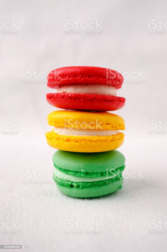 Different kind of macaroons in stack on white background, traffic light sweet conceptual, copy space stock photo