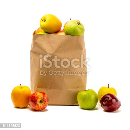 Different apples, green, yellow and red, into a carton bag ready to send or storage.