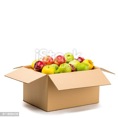 Different apples, green, yellow and red, into a carton box ready to send or storage.