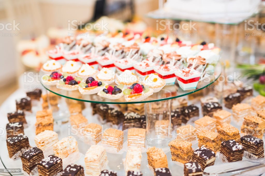 Different kinds of baked sweets on a buffet stock photo