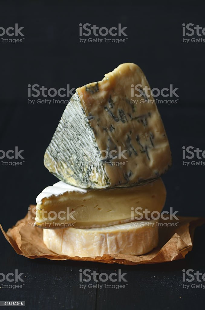 Different kinds of cheeses stock photo